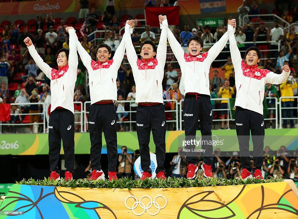 Gold medalists team Japan member Ryohei Kato Kenzo Shirai Yusuke Tanaka Kohei Uchimura and Koji Yamamuro celebrate on the podium at the medal...