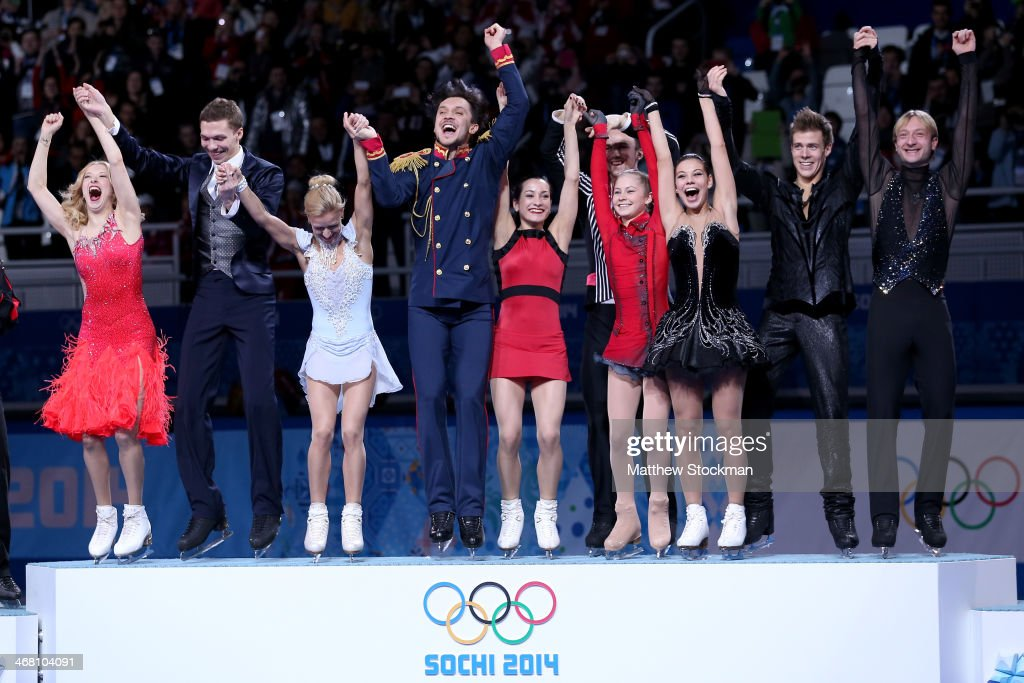 Gold medalists team Russia celebrate during the flower ceremony for the Team Figure Skating Overall during day two of the Sochi 2014 Winter Olympics at Iceberg Skating Palace onon February 9, 2014 in Sochi, Russia.
