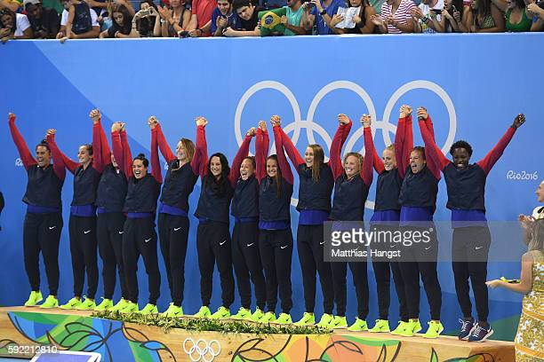 Gold medalists Team United States celebrate on the podium during the medal ceremony for the Women's Water Polo Gold Medal match between the United...