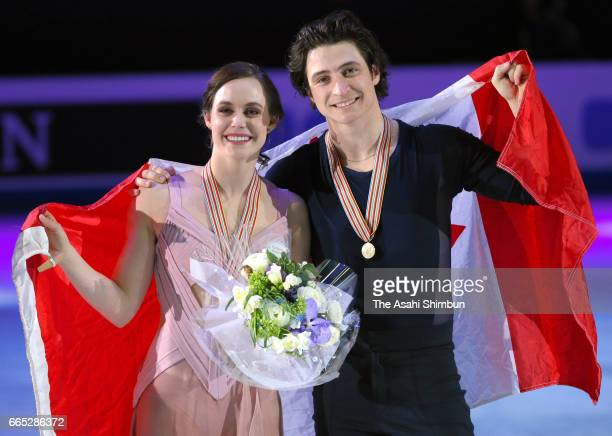 Gold medalists Tessa Virtue and Scott Moir of Canada pose for photographs after the medal ceremony for Ice Dance during day four of the World Figure...