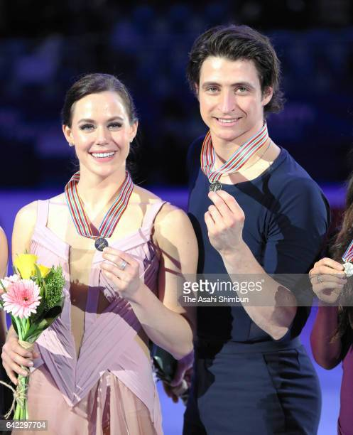 Gold medalists Tessa Virtue and Scott Moir of Canada pose on the podium at the medal ceremony for the Ice Dance during day two of the ISU Four...