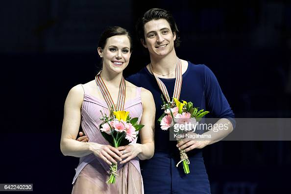 Gold medalists Tessa Virtue and Scott Moir of Canada pose on the podium during the medals ceremony of the Ice Dance in ISU Four Continents Figure...