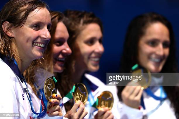 Gold medalists The United States pose with the medals won during the Womens 4x200m Freestyle final on day fourteen of the Budapest 2017 FINA World...