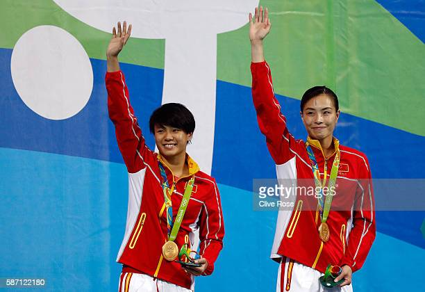 Gold medalists Tingmao Shi and Minxia Wu of China pose on the podium during the medal ceremony for the Women's Diving Synchronised 3m Springboard...