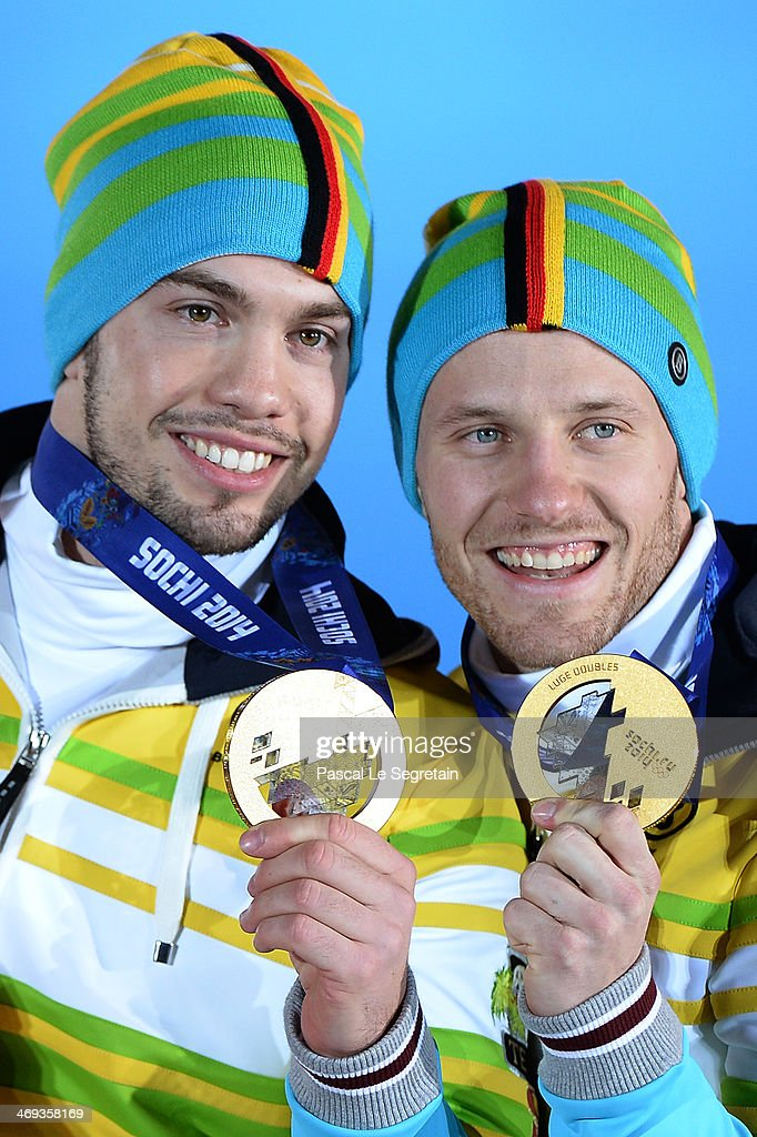 Gold medalists <a gi-track='captionPersonalityLinkClicked' href=/galleries/search?phrase=Tobias+Wendl&family=editorial&specificpeople=4784289 ng-click='$event.stopPropagation()'>Tobias Wendl</a> (L) and <a gi-track='captionPersonalityLinkClicked' href=/galleries/search?phrase=Tobias+Arlt&family=editorial&specificpeople=4784288 ng-click='$event.stopPropagation()'>Tobias Arlt</a> of Germany celebrate during the medal ceremony for the Men's Luge Doubles on day 7 of the Sochi 2014 Winter Olympics at Medals Plaza on February 14, 2014 in Sochi, Russia.