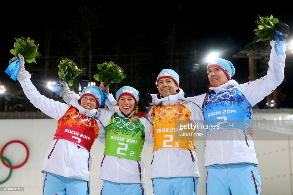 Gold medalists <a gi-track='captionPersonalityLinkClicked' href=/galleries/search?phrase=Tora+Berger&family=editorial&specificpeople=812729 ng-click='$event.stopPropagation()'>Tora Berger</a> of Norway, <a gi-track='captionPersonalityLinkClicked' href=/galleries/search?phrase=Tiril+Eckhoff&family=editorial&specificpeople=10023336 ng-click='$event.stopPropagation()'>Tiril Eckhoff</a> of Norway, <a gi-track='captionPersonalityLinkClicked' href=/galleries/search?phrase=Ole+Einar+Bjoerndalen&family=editorial&specificpeople=206663 ng-click='$event.stopPropagation()'>Ole Einar Bjoerndalen</a> of Norway and <a gi-track='captionPersonalityLinkClicked' href=/galleries/search?phrase=Emil+Hegle+Svendsen&family=editorial&specificpeople=831528 ng-click='$event.stopPropagation()'>Emil Hegle Svendsen</a> of Norway celebrate during the flower ceremony for the 2 x 6 km Women + 2 x 7 km Men Mixed Relay during day 12 of the Sochi 2014 Winter Olympics at Laura Cross-country Ski & Biathlon Center on February 19, 2014 in Sochi, Russia.