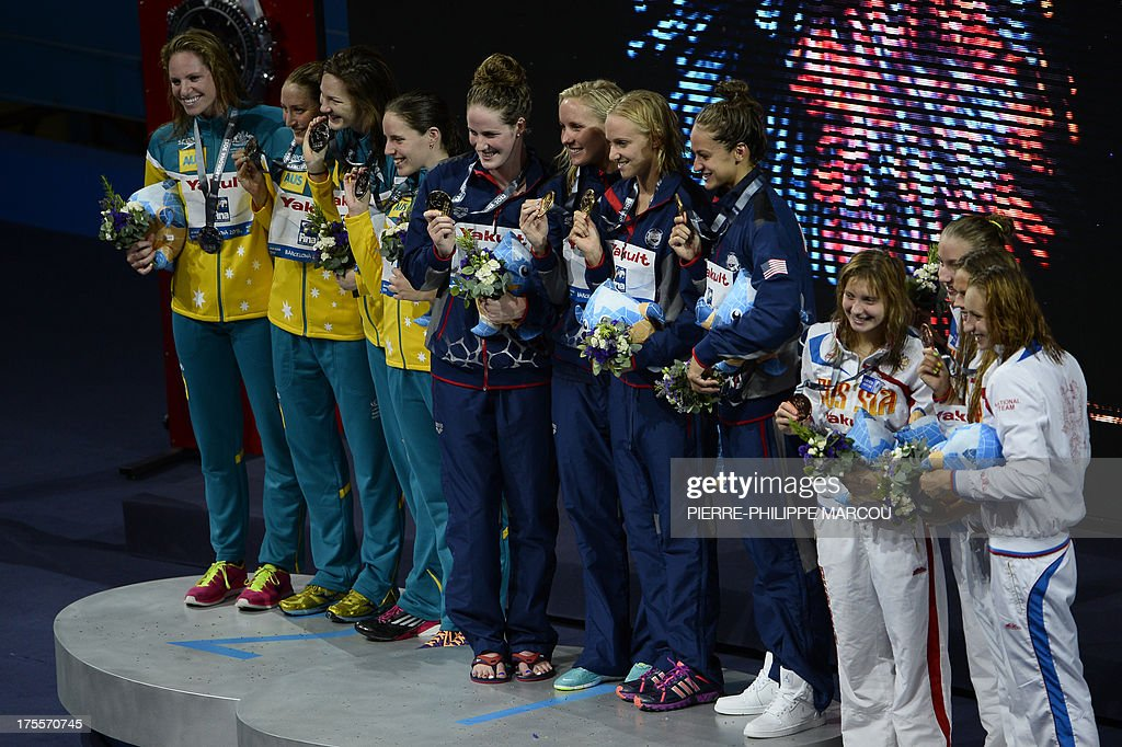 Gold medalists US swimmers Jessica Hardy, Megan Romano, Dana Vollmer and Missy Franklin (C), silver medalists Australia's Sally Foster, Emily Seebohn, Alicia Coutts and Cate Campbell (L) and bronze medalists Russia's Veronika Popova, Daria Ustinova, Sveltana Chimrova and Yuliya Efimova (R) pose on the podium during the award ceremony of the women's 4x100-metre medley relay swimming event in the FINA World Championships at Palau Sant Jordi in Barcelona on August 4, 2013. AFP PHOTO / PIERRE-PHILIPPE MARCOU