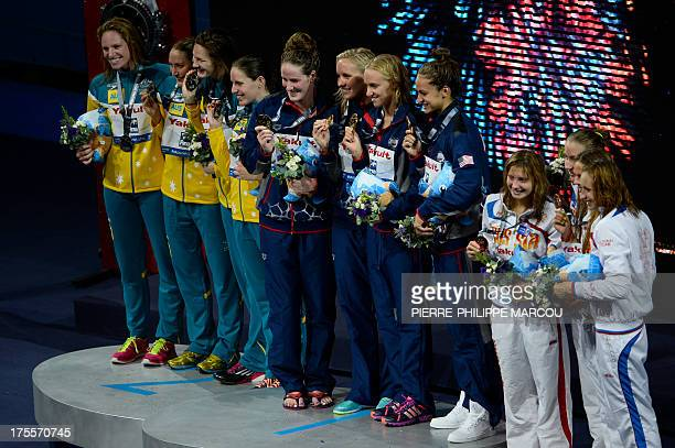 Gold medalists US swimmers Jessica Hardy Megan Romano Dana Vollmer and Missy Franklin silver medalists Australia's Sally Foster Emily Seebohn Alicia...