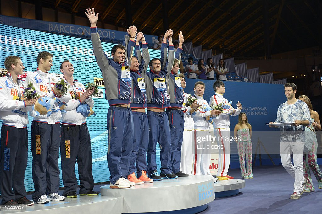 Gold medalists US swimmers Ricky Berens, Charles Gipson Houchin, Ryan Lochte and Conor Dwyer (C), silver medalists Russia's Artem Lobuzov, Alexander Sukhorukov, Danila Izotov and Nikita Lobintsev (L) and bronze medalists China's Sun Yang, Hao Yun, Li Yunqi and Wang Shun celebrate on the podium during the award ceremony of the men's 4x200-metre freestyle relay swimming event in the FINA World Championships at Palau Sant Jordi in Barcelona on August 2, 2013. AFP PHOTO / LLUIS GENE