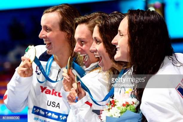 Gold medalists USA's Katie Ledecky USA's Melanie Margalis USA's Mallory Comerford and USA's Leah Smith celebrate on the podium in the Women's 4x200m...