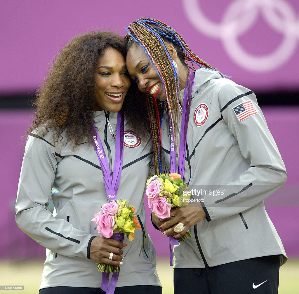 Gold medalists Venus Williams and Serena Williams of the United States celebrate during the medal ceremony for the Women's Doubles Tennis on Day 9 of the London 2012 Olympic Games at the All England Lawn Tennis and Croquet Club on August 5, 2012 in London, England.