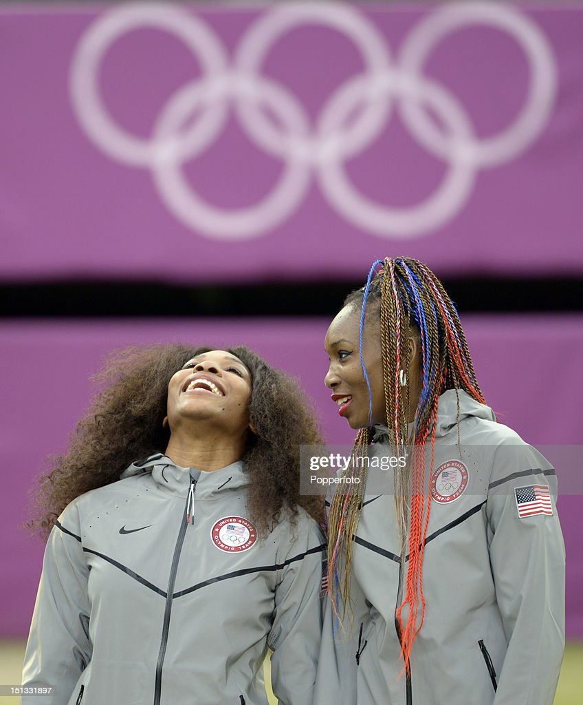 Gold medalists Venus Williams (R) and Serena Williams of the United States celebrate during the medal ceremony for the Women's Doubles Tennis on Day 9 of the London 2012 Olympic Games at the All England Lawn Tennis and Croquet Club on August 5, 2012 in London, England.