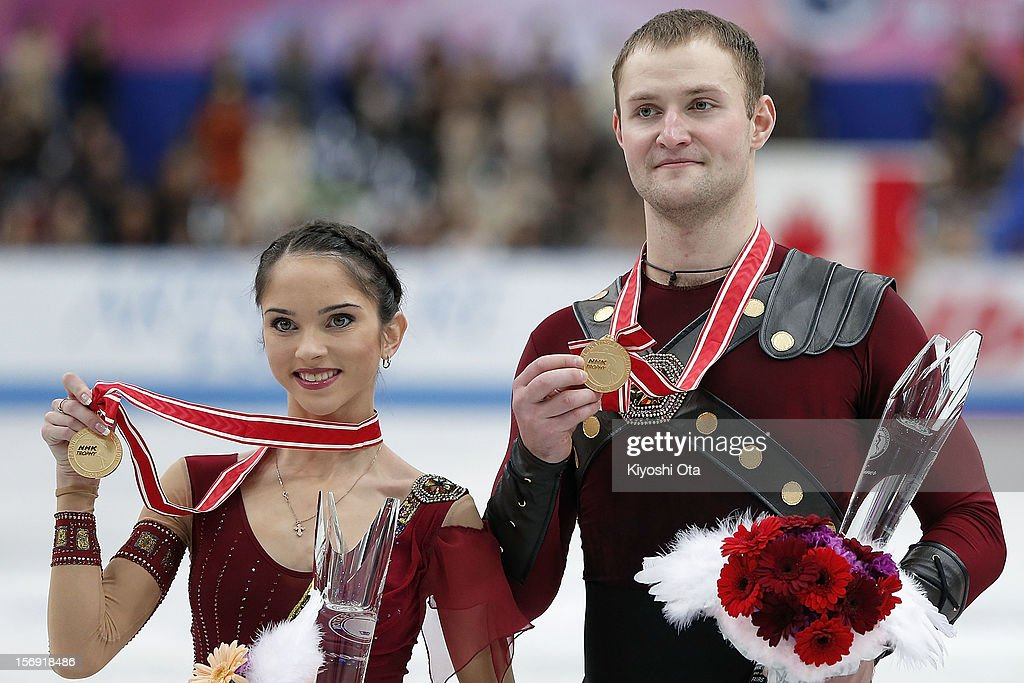Gold medalists Vera Bazarova and Yuri Larionov of Russia pose for photographs at the medal ceremony after the Pairs competition during day three of the ISU Grand Prix of Figure Skating NHK Trophy at Sekisui Heim Super Arena on November 25, 2012 in Rifu, Japan.