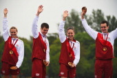 Gold medalists Vicky Holland Jonathan Brownlee Jodie Stimpson and Alistair Brownlee of England celebrate on the podium during the medal ceremony for...