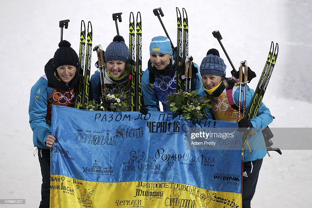 Gold medalists <a gi-track='captionPersonalityLinkClicked' href=/galleries/search?phrase=Vita+Semerenko&family=editorial&specificpeople=4894891 ng-click='$event.stopPropagation()'>Vita Semerenko</a>, <a gi-track='captionPersonalityLinkClicked' href=/galleries/search?phrase=Juliya+Dzhyma&family=editorial&specificpeople=10101687 ng-click='$event.stopPropagation()'>Juliya Dzhyma</a>, <a gi-track='captionPersonalityLinkClicked' href=/galleries/search?phrase=Olena+Pidhrushna&family=editorial&specificpeople=6567208 ng-click='$event.stopPropagation()'>Olena Pidhrushna</a> and Valj Semerenko of Ukraine celebrate after the flower ceremony for the Biathlon Women's 4 x 6 km Relay during day 14 of the Sochi 2014 Winter Olympics at Laura Cross-country Ski & Biathlon Center on February 21, 2014 in Sochi, Russia.