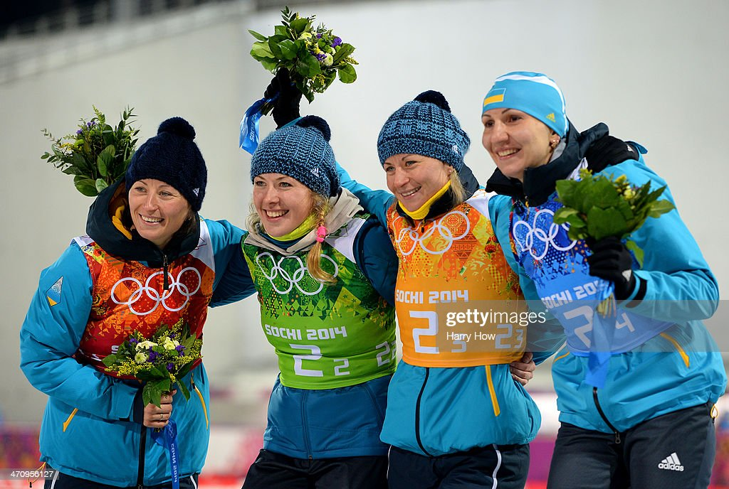 Gold medalists <a gi-track='captionPersonalityLinkClicked' href=/galleries/search?phrase=Vita+Semerenko&family=editorial&specificpeople=4894891 ng-click='$event.stopPropagation()'>Vita Semerenko</a>, <a gi-track='captionPersonalityLinkClicked' href=/galleries/search?phrase=Juliya+Dzhyma&family=editorial&specificpeople=10101687 ng-click='$event.stopPropagation()'>Juliya Dzhyma</a>, <a gi-track='captionPersonalityLinkClicked' href=/galleries/search?phrase=Olena+Pidhrushna&family=editorial&specificpeople=6567208 ng-click='$event.stopPropagation()'>Olena Pidhrushna</a> and Valj Semerenko of Ukraine celebrate during the flower ceremony for the Biathlon Women's 4 x 6 km Relay during day 14 of the Sochi 2014 Winter Olympics at Laura Cross-country Ski & Biathlon Center on February 21, 2014 in Sochi, Russia.