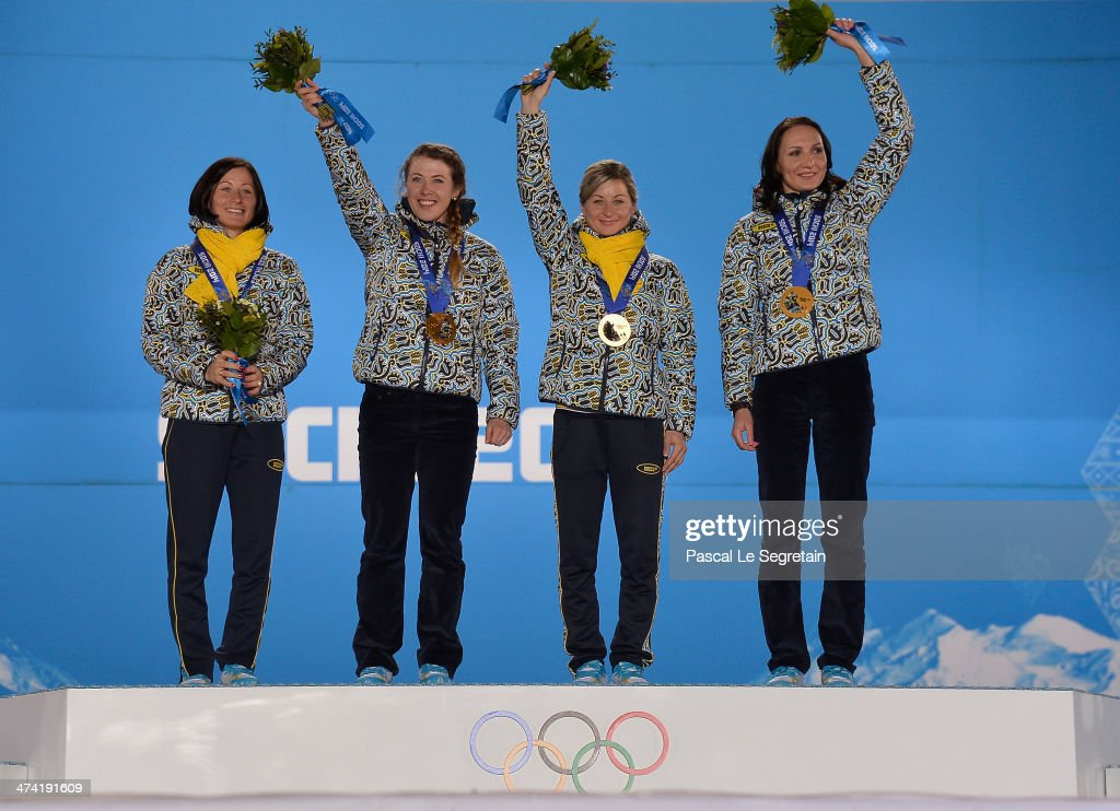 Gold medalists <a gi-track='captionPersonalityLinkClicked' href=/galleries/search?phrase=Vita+Semerenko&family=editorial&specificpeople=4894891 ng-click='$event.stopPropagation()'>Vita Semerenko</a>, <a gi-track='captionPersonalityLinkClicked' href=/galleries/search?phrase=Juliya+Dzhyma&family=editorial&specificpeople=10101687 ng-click='$event.stopPropagation()'>Juliya Dzhyma</a>, Valj Semerenko and <a gi-track='captionPersonalityLinkClicked' href=/galleries/search?phrase=Olena+Pidhrushna&family=editorial&specificpeople=6567208 ng-click='$event.stopPropagation()'>Olena Pidhrushna</a> of Ukraine celebrate during the medal ceremony for the Biathlon Women's 4 x 6 km Relay on Day 15 of the Sochi 2014 Winter Olympics at Medals Plaza on February 22, 2014 in Sochi, Russia.