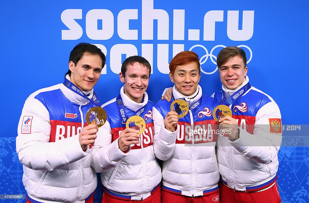 Gold medalists <a gi-track='captionPersonalityLinkClicked' href=/galleries/search?phrase=Vladimir+Grigorev&family=editorial&specificpeople=8717249 ng-click='$event.stopPropagation()'>Vladimir Grigorev</a>, <a gi-track='captionPersonalityLinkClicked' href=/galleries/search?phrase=Ruslan+Zakharov&family=editorial&specificpeople=4114906 ng-click='$event.stopPropagation()'>Ruslan Zakharov</a>, Victor An and <a gi-track='captionPersonalityLinkClicked' href=/galleries/search?phrase=Semen+Elistratov&family=editorial&specificpeople=8823657 ng-click='$event.stopPropagation()'>Semen Elistratov</a> of Russia celebrate on the podium during the medal ceremony for the Men's 5000m Relay on Day 15 of the Sochi 2014 Winter Olympics at Medals Plaza on February 22, 2014 in Sochi, Russia.