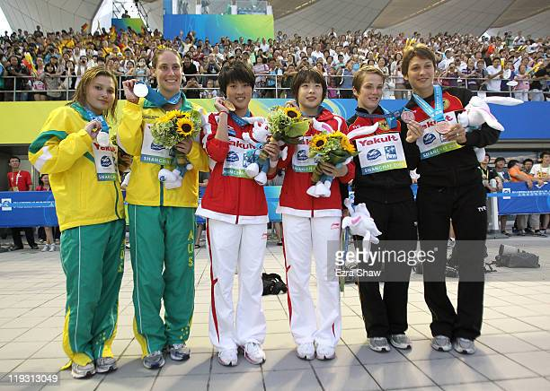 Gold medalists Wang Hao and Chen Ruolin of the People's Republic of China celebrate with silver medalists Melissa Wu and Alexandra Croak of Australia...