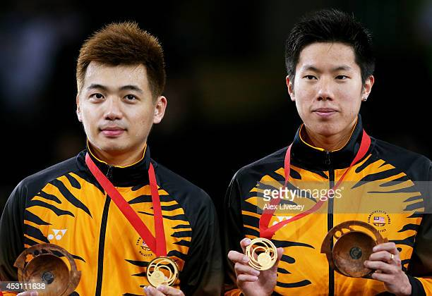 Gold medalists Wee Kiong Tan and Mas Wei Shem of Malaysia pose in the medal ceremony for the Men's Doubles Gold Medal Match at Emirates Arena during...