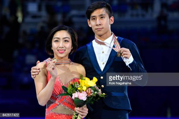 Gold medalists Wenjing Sui and Cong Han of China pose on the podium during the medals ceremony of the Pairs during ISU Four Continents Figure Skating...