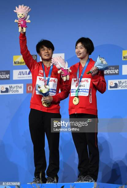 Gold medalists Yani Chang and Tingmao Shi of China pose with the medals won during the Women's Diving 3M Synchro Springboard final on day four of the...