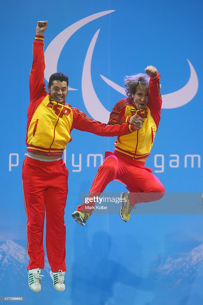 Gold medalist's Yon Santacana Maiztegui (R) and guide Miguel Galindo Garces (L) jump as they celebrate at the medal ceremony for the Men's Downhill Visually Impaired during day one of Sochi 2014 Paralympic Winter Games at Laura Cross-country Ski & Biathlon Center on March 8, 2014 in Sochi, Russia.