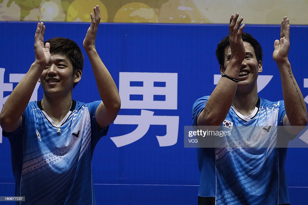 Gold medalists Yong Dae Lee (L) and Sung Hyun Ko of South Korea pose on the podium after winning the men's doubles final match against Kenichi Hayakawa and Hiroyuki Endo of Japan on day 6 of the 2013 China Badminton Masters at Changzhou Olympic Sports Center on September 15, 2013 in Changzhou, China.