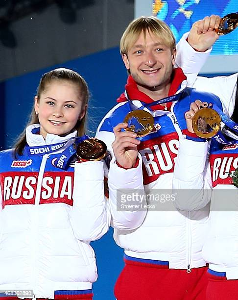 Gold medalists Yulia Lipnitskaya and Evgeny Plyushchenko of Russia celebrate during the medal ceremony for the Team Figure Skating Overall on day 3...