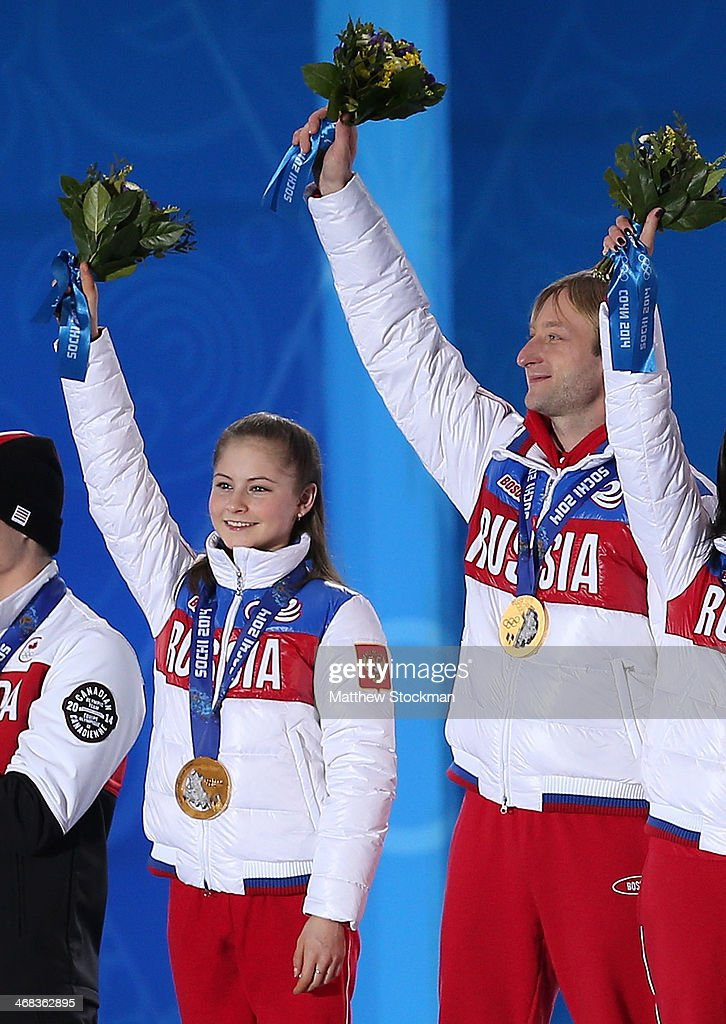 Gold medalists Yulia Lipnitskaya (L) and Evgeny Plyushchenko of Russia celebrate during the medal ceremony for the Team Figure Skating Overall on day 3 of the Sochi 2014 Winter Olympics at Medals Plaza in the Olympic Park on February 10, 2014 in Sochi, Russia.