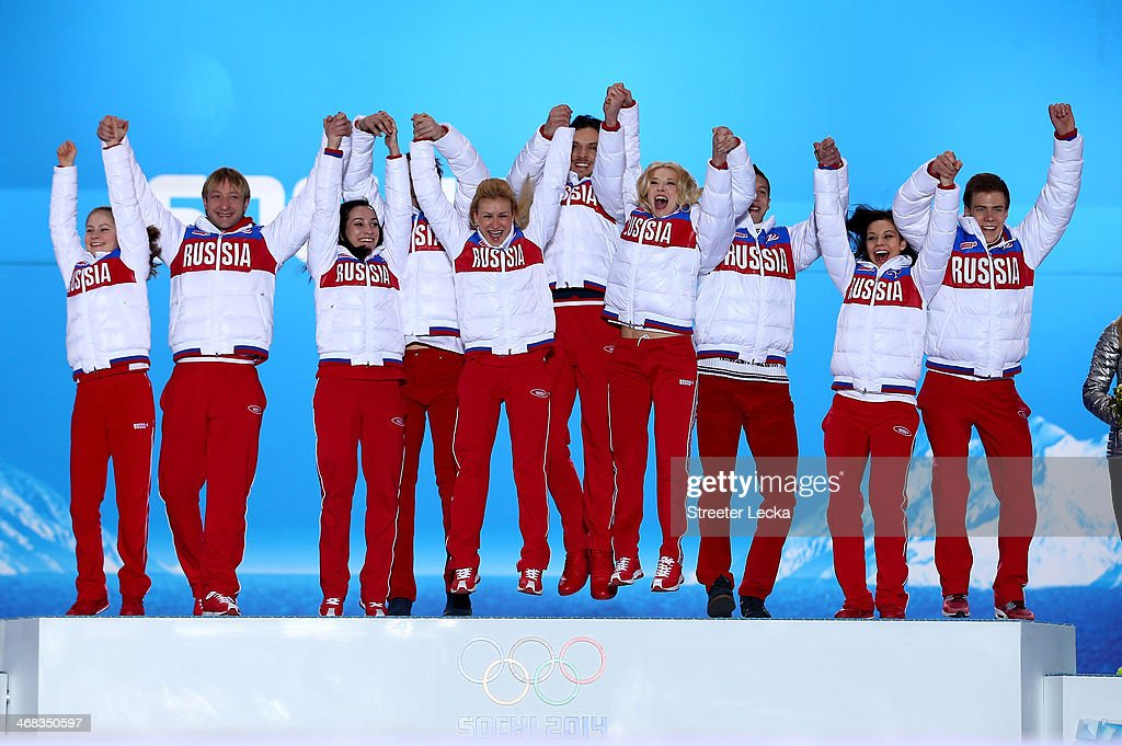 Gold medalists Yulia Lipnitskaya, Evgeny Plyushchenko, <a gi-track='captionPersonalityLinkClicked' href=/galleries/search?phrase=Ksenia+Stolbova&family=editorial&specificpeople=7338286 ng-click='$event.stopPropagation()'>Ksenia Stolbova</a>, <a gi-track='captionPersonalityLinkClicked' href=/galleries/search?phrase=Fedor+Klimov&family=editorial&specificpeople=7338285 ng-click='$event.stopPropagation()'>Fedor Klimov</a>, <a gi-track='captionPersonalityLinkClicked' href=/galleries/search?phrase=Tatiana+Volosozhar&family=editorial&specificpeople=798077 ng-click='$event.stopPropagation()'>Tatiana Volosozhar</a>, <a gi-track='captionPersonalityLinkClicked' href=/galleries/search?phrase=Maxim+Trankov&family=editorial&specificpeople=798054 ng-click='$event.stopPropagation()'>Maxim Trankov</a>, <a gi-track='captionPersonalityLinkClicked' href=/galleries/search?phrase=Ekaterina+Bobrova&family=editorial&specificpeople=4607767 ng-click='$event.stopPropagation()'>Ekaterina Bobrova</a>, <a gi-track='captionPersonalityLinkClicked' href=/galleries/search?phrase=Dmitri+Soloviev&family=editorial&specificpeople=4607766 ng-click='$event.stopPropagation()'>Dmitri Soloviev</a>, <a gi-track='captionPersonalityLinkClicked' href=/galleries/search?phrase=Elena+Ilinykh&family=editorial&specificpeople=7281567 ng-click='$event.stopPropagation()'>Elena Ilinykh</a> and <a gi-track='captionPersonalityLinkClicked' href=/galleries/search?phrase=Nikita+Katsalapov&family=editorial&specificpeople=7281568 ng-click='$event.stopPropagation()'>Nikita Katsalapov</a> of Russia celebrate during the medal ceremony for the Team Figure Skating Overall on day 3 of the Sochi 2014 Winter Olympics at Medals Plaza in the Olympic Park on February 10, 2014 in Sochi, Russia.