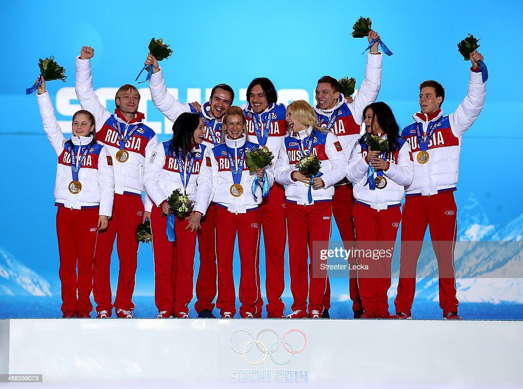 Gold medalists Yulia Lipnitskaya, Evgeny Plyushchenko, Ksenia Stolbova, Fedor Klimov, Tatiana Volosozhar, Maxim Trankov, Ekaterina Bobrova, Dmitri Soloviev, Elena Ilinykh and Nikita Katsalapov of Russia celebrate during the medal ceremony for the Team Figure Skating Overall on day 3 of the Sochi 2014 Winter Olympics at Medals Plaza in the Olympic Park on February 10, 2014 in Sochi, Russia.