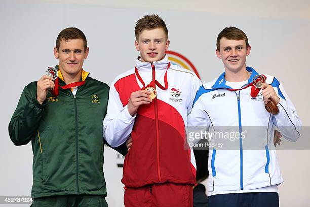 Gold medallist Adam Peaty of England poses with silver medallist Cameron van der Burgh of South Africa and bronze medallist Ross Murdoch of Scotland...