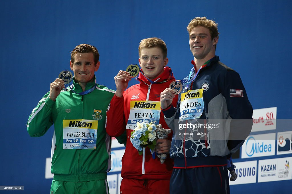Gold medallist <a gi-track='captionPersonalityLinkClicked' href=/galleries/search?phrase=Adam+Peaty+-+Swimmer&family=editorial&specificpeople=11074368 ng-click='$event.stopPropagation()'>Adam Peaty</a> of Great Britain poses with silver medallist Cameron van der Burgh of South Africa and bronze medallist <a gi-track='captionPersonalityLinkClicked' href=/galleries/search?phrase=Kevin+Cordes&family=editorial&specificpeople=10030815 ng-click='$event.stopPropagation()'>Kevin Cordes</a> of the United States during the medal ceremony for the Men's 50m Breaststroke Final on day twelve of the 16th FINA World Championships at the Kazan Arena on August 5, 2015 in Kazan, Russia.