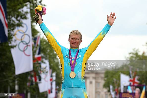 Gold medallist Alexandr Vinokurov of Kazakhstan celebrates during the Victory Ceremony for the Men's Road Race Road Cycling on day 1 of the London...