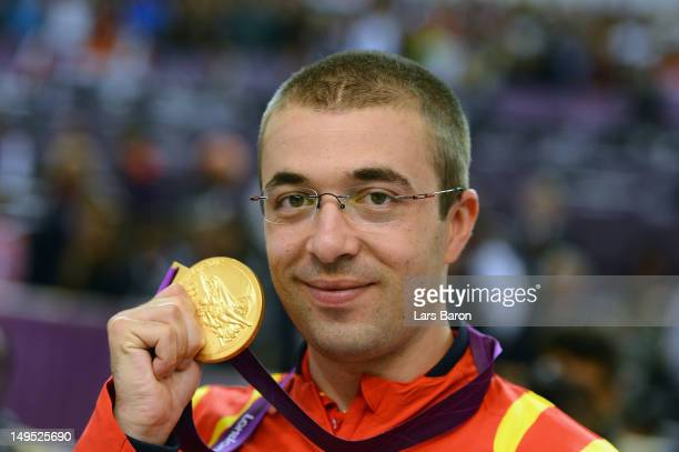Gold medallist Alin George Moldoveanu of Romania poses with the gold medal won in the Men's 10m Air Rifle Shooting final final on Day 3 of the London...