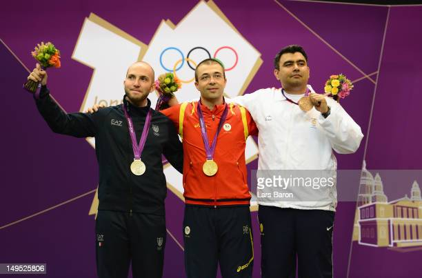 Gold medallist Alin George Moldoveanu of Romania silver medallist Niccolo Campriani of Italy and bronze medallist Gagan Narang of India pose on the...