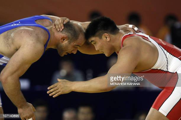 Gold medallist Artur Taymazov of Uzbekistan takes on Chuluubat Jargalsaikhan of Mongolia who won the silver medal during the men�s Freestyle 120kg...