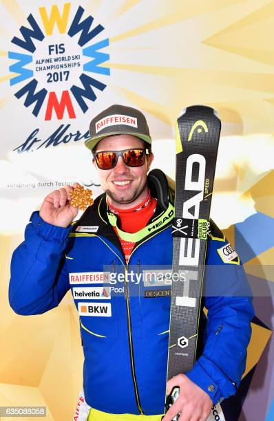 Gold medallist Beat Feuz of Switzerland poses during the medal ceremony for the Men's Downhill during the FIS Alpine World Ski Championships on...