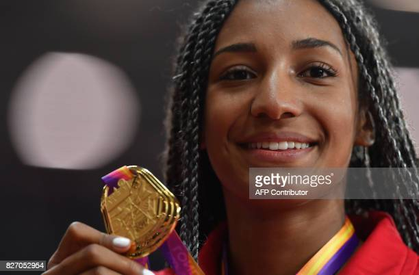 Gold medallist Belgium's Nafissatou Thiam poses on the podium during the victory ceremony for the women's heptathlon athletics event at the 2017 IAAF...