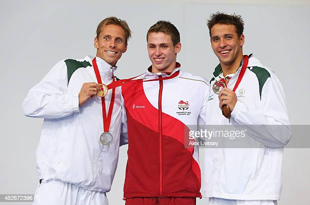 Gold medallist Benjamin Proud of England poses with silver medallist Roland Schoeman of South Africa and bronze medallist Chad le Clos of South...