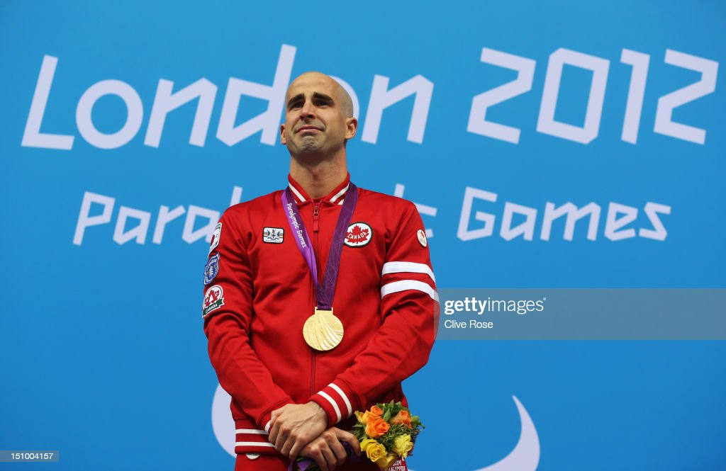 Gold medallist Benoit Huot of Canada poses on the podium during the medal ceremony for the Men's 200m Individual Medley -SM10 final on day 1 of the London 2012 Paralympic Games at Aquatics Centre on August 30, 2012 in London, England.