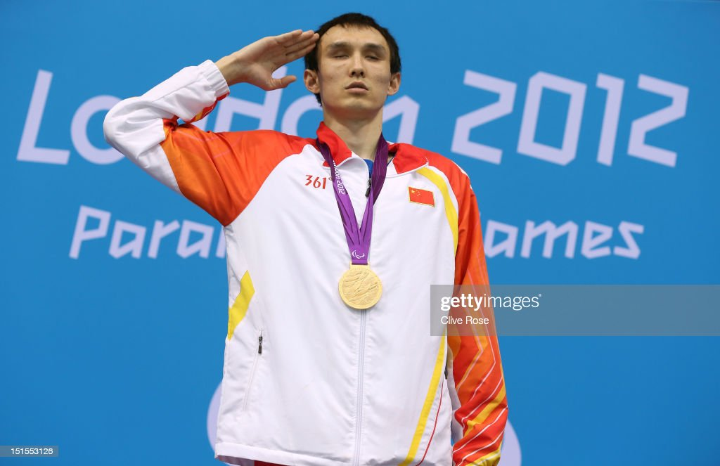 Gold medallist Bozun Yang of China and bronze medallist Oleksandr Maschenko of Ukraine pose on the podium during the medal ceremony for the Men's 200m Individual Medley -SM11 final on day 10 of the London 2012 Paralympic Games at Aquatics Centre on September 8, 2012 in London, England.
