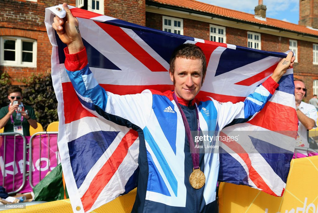 Gold medallist Bradley Wiggins of Great Britain celebrates after the victory ceremony after the Men's Individual Time Trial Road Cycling on day 5 of the London 2012 Olympic Games on August 1, 2012 in London, England.