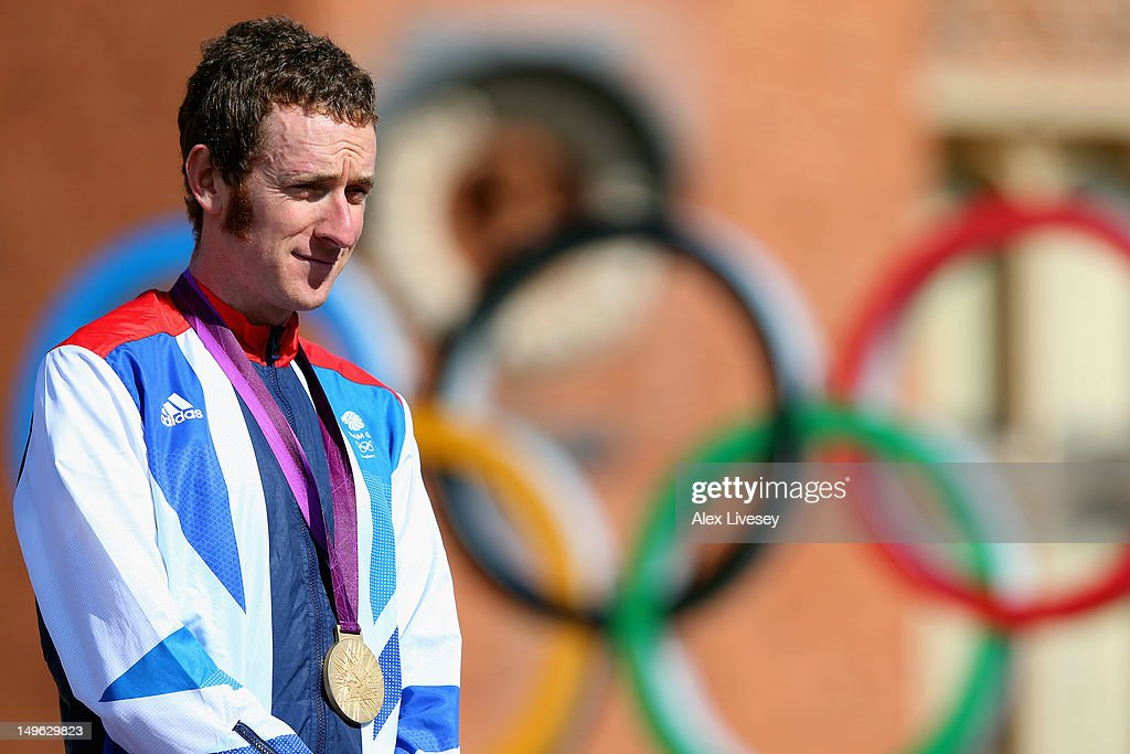 Gold medallist Bradley Wiggins of Great Britain celebrates during the victory ceremony after the Men's Individual Time Trial Road Cycling on day 5 of...