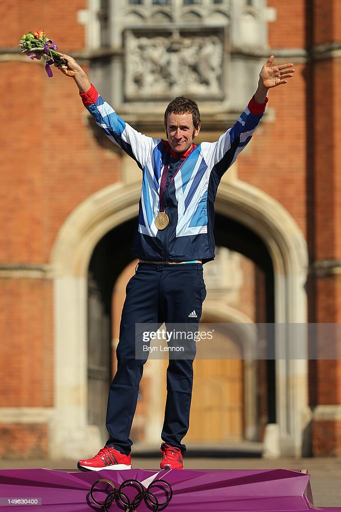 Gold medallist Bradley Wiggins of Great Britain celebrates during the victory ceremony after the Men's Individual Time Trial Road Cycling on day 5 of the London 2012 Olympic Games on August 1, 2012 in London, England.