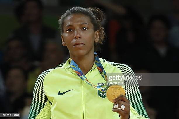 Gold medallist Brazil's Rafaela Silva celebrates on the podium of the women's 57kg judo contest of the Rio 2016 Olympic Games in Rio de Janeiro on...