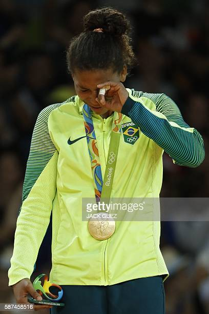 TOPSHOT Gold medallist Brazil's Rafaela Silva celebrates on the podium of the women's 57kg judo contest of the Rio 2016 Olympic Games in Rio de...