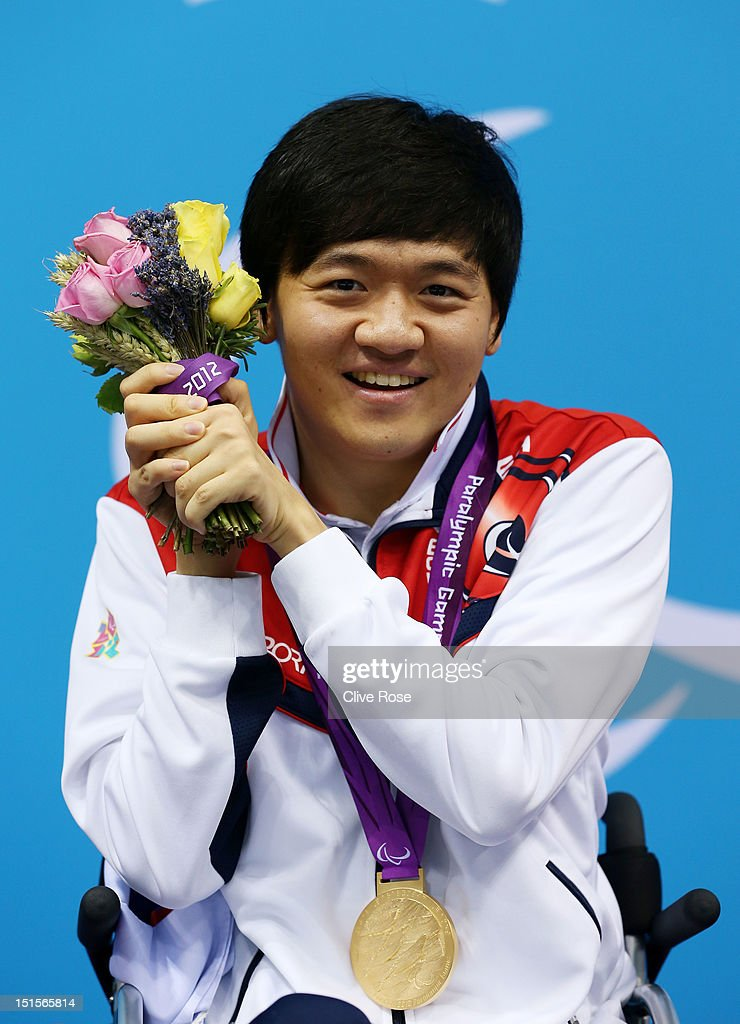 Gold medallist Byeong-Eon Min of Korea poses on the podium during the medal ceremony for the Men's 50m Backstroke - S3 final on day 10 of the London 2012 Paralympic Games at Aquatics Centre on September 8, 2012 in London, England.
