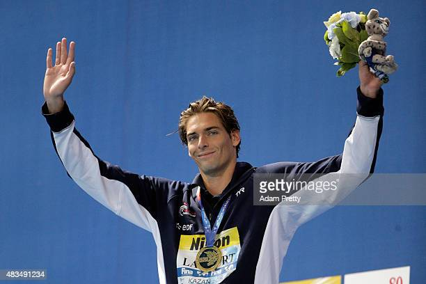 Gold medallist Camille Lacourt of France celebrates during the medal ceremony for the Men's 50m Backstroke Final on day sixteen of the 16th FINA...